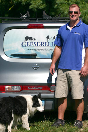 Photo of the owner and one of his four legged employee