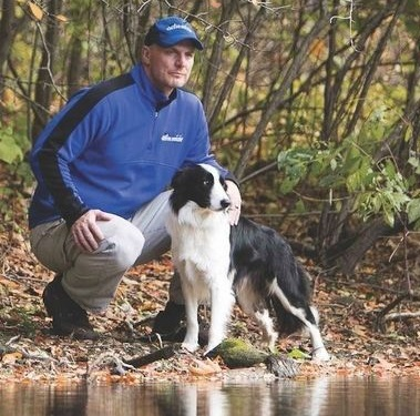 Chris with Chip, one of the Geese Relief border collies